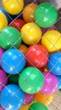 Colourful kid ball in net cage background Royalty Free Stock Photography