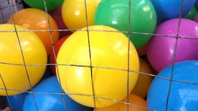 Colourful kid ball in net cage Royalty Free Stock Image