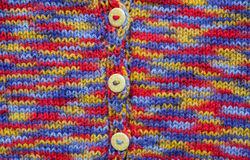 Colourful kids knitted cardigan background Stock Image