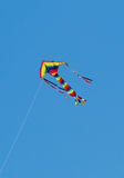 Colourful kite against blue sky Stock Photo