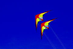 Colourful kites against a blue sky. Kites fly in the sky with blue background Royalty Free Stock Photography
