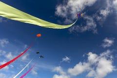5 colourful kites in a blue summer`s sky stock photos