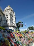Colourful  kites tunnel in the wind under bright blue sky Royalty Free Stock Photography