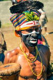 Colourful knitted cap in Papua New Guinea. Wabag, Papua New Guinea - circa August 2015: Native half-naked man during traditional Enga cultural show in Wabag Stock Images