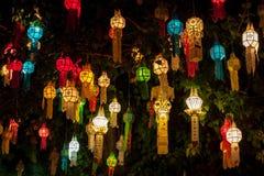 Colourful lantern light on sacred Bodhi tree. Colourful lantern light on sacred Bodhi tree during thai lantern festival. Beginning of Loy Krathong lantern royalty free stock images