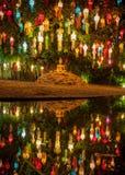 Colourful lanterns above Buddha image during thai. Colourful lanterns above Buddha image during thai lantern festival. Beginning of Loy Krathong lantern Stock Photography