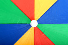 Colourful Large Open Beach Umbrella Yellow Blue Red and Green. A DSLR royalty free image, of Open Beach Umbrella taking up all the frame, with green, blue, red Royalty Free Stock Photos