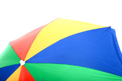 Colourful Large Open Beach Umbrella Yellow Red and Green. A DSLR royalty free image, of colourful beach umbrella, green, red, blue, yellow, shot against a white Royalty Free Stock Photography