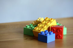 Colourful lego bricks on wooden background royalty free stock images
