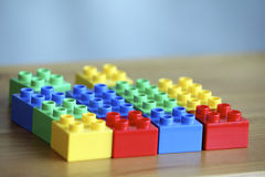 Colourful lego bricks on wooden background Stock Image