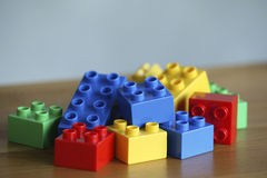 Colourful lego bricks on wooden background royalty free stock photo
