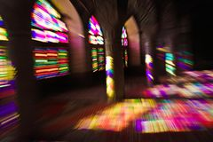 Colourful light spread through stained glass stock photography
