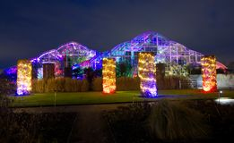 Colourful lights illuminate the glasshouse at Wisley, Surrey. Stock Image