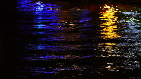 Colourful Lights from Pier on the Water. Seaside stock video