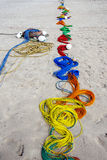 A colourful line of fishing rope on Uppuveli beach in Sri Lanka. Royalty Free Stock Photography