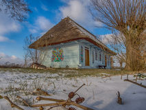 Colourful  log house winter time Royalty Free Stock Photography