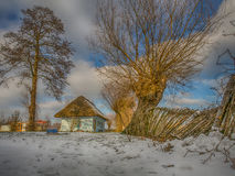 Colourful  log house winter time Stock Image
