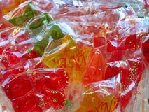 Colourful lollipops on a market stall stock image