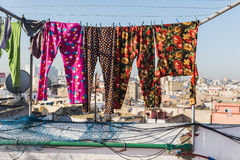 The colourful long plants bask on the clothes line. On the roof top of building in Casablanca, Morocco Royalty Free Stock Images