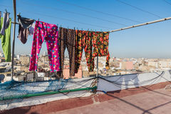 The colourful long plants bask on the clothes line. On the roof top of building in Casablanca, Morocco Royalty Free Stock Photo