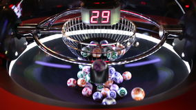 Colourful lottery balls in a sphere stock video