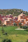 Colourful luxury houses and apartments on Duquesa golf course in Stock Photo