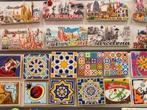 Colourful magnets on a wall in a souvenir shop in Barcelona, Spain Royalty Free Stock Image