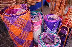 Colourful Malay traditional mats. SELANGOR, MALAYSIA – AUGUST 28, 2014: Colourful Malay traditional mats made from dried pine Stock Photos