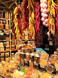 Colourful market and food, la Boqueria in Barcelona city, Catalonia, Spain. Spices, onions, chili peppers, enchanting atmosphere and famous touristic place stock photography