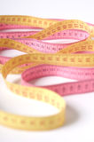 Colourful measuring tape set in waves Stock Photography