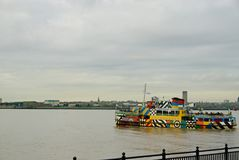 The colourful Mersey Dazzle ferry. The brightly colored Mersey ferry setting off to cross the river Mersey over to Birkenhead. One of the most colourful Stock Photos