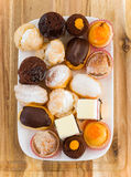 Colourful mini cakes tray on wood Royalty Free Stock Image