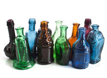 Colourful miniature bottles. A variety of different shaped coloured bottles Stock Image