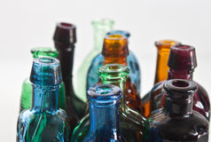 Colourful minitature bottles. A closeup of colourful bottles with soft focus Stock Image