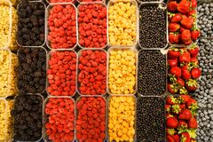 Colourful mix of different fresh berries at market.  Royalty Free Stock Image