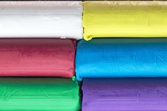 Colourful modelling clay, stack of colored dough. A stack of modeling clay with various colourful colors in white, yellow, red, blue, green and purple stock photography