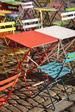 Colourful modern trendy tables and chairs at street cafe Royalty Free Stock Photography