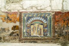 Mosaic wall plaque showing the sea god Neptune and his wife in Herculaneum, Italy. Colourful mosaic plaque showing the sea god Neptune and his wife, Amphitrite Stock Photos