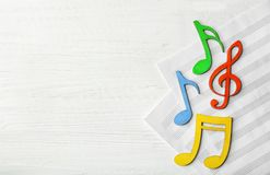 Colourful musical notes lying on music sheets stock photos