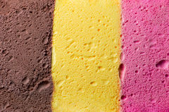 Colourful Neapolitan ice cream background texture. Colourful Neapolitan ice cream background and texture Royalty Free Stock Photos