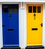 Colourful neighbours. Two brightly coloured doors in a village in England, UK Stock Photo