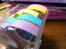 Colourful note paper. On working desk in office stock image