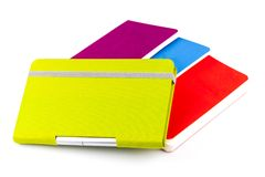 Colourful notebooks with ballpoint pen. Isolated on white background Royalty Free Stock Photos