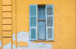 Colourful old building window shutters Stock Photo