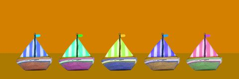 Colourful old wooden toy boats banner stock photos