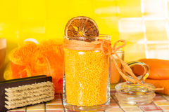 Colourful orange bath salts in a bathroom Royalty Free Stock Photo