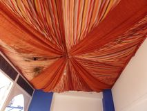 Colourful orange Moroccan ceiling canopy stock image