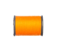 Colourful orange thread isolated on white Royalty Free Stock Images