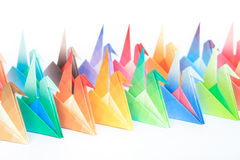 Colourful origami birds. 2 rows of colourful origami birds facing the same direction, on a white background. Shallow depth of field. Focus on the yellow and Stock Photography