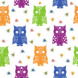 Colourful owl and stars seamless pattern. With lace ornamental bodies and without contour lines, hand drawing cartoon vector illustration Royalty Free Stock Image